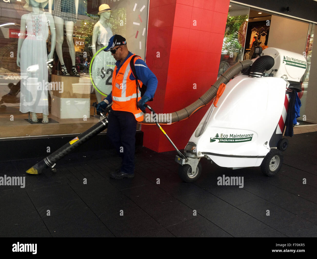 AUCKLAND - NOV 23 2015:Street cleaner operate industrial waste vacuum cleaner.Every year Aucklanders send 1.2 million - Stock Image