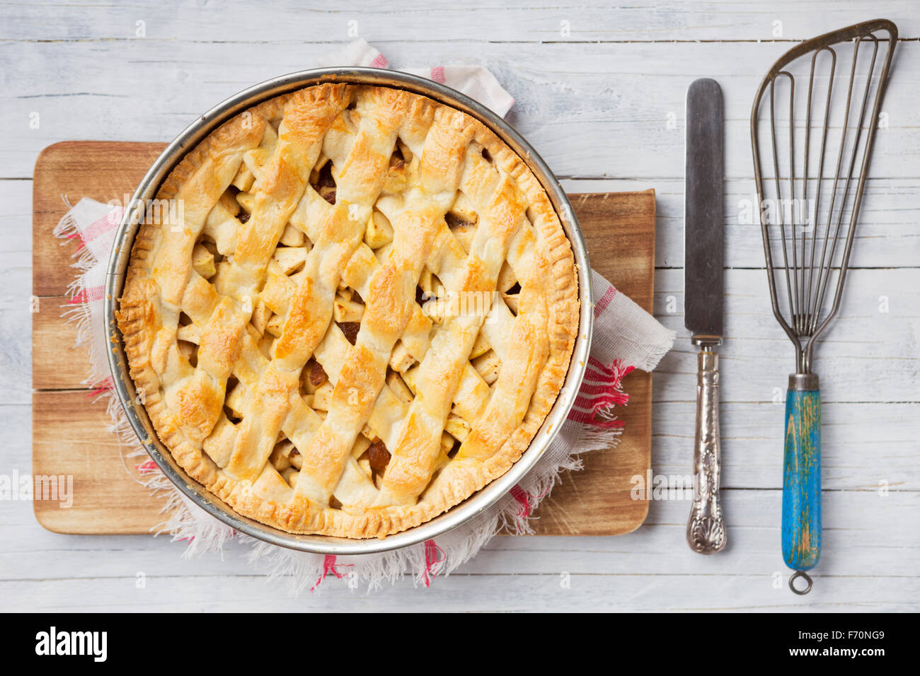 Homemade Dutch apple pie on a rustic table. Photographed from directly above. - Stock Image