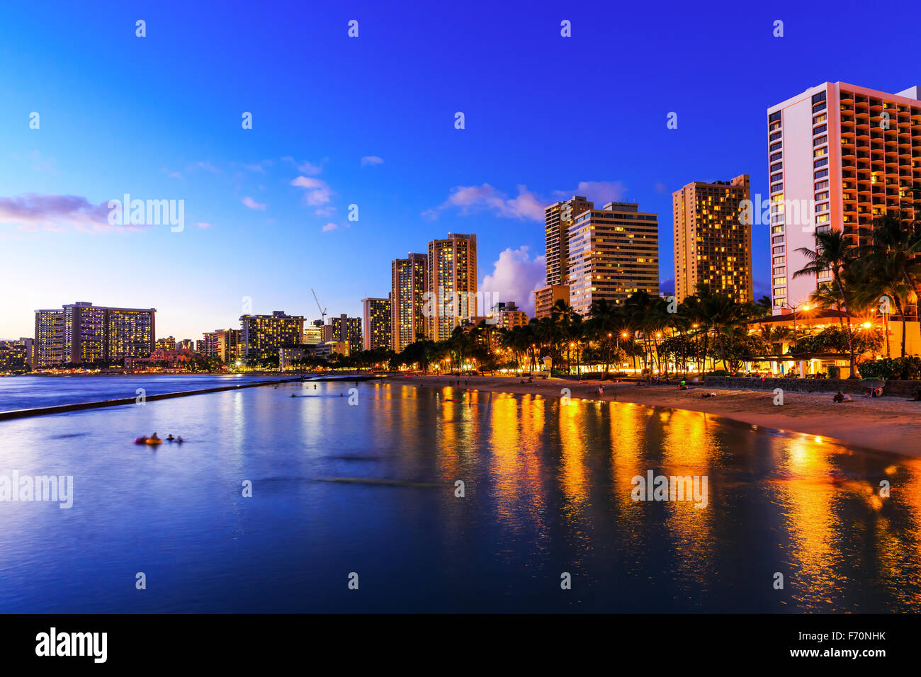 View of Honolulu and Waikiki Beach at night; Hawaii, USA - Stock Image