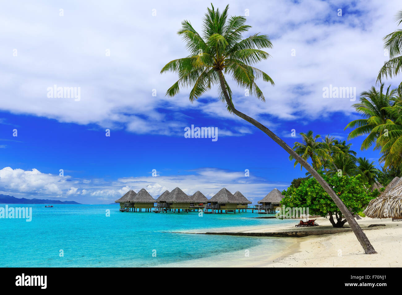 Over-water bungalows of luxury tropical resort, Bora Bora island, near Tahiti, French Polynesia, Pacific ocean - Stock Image