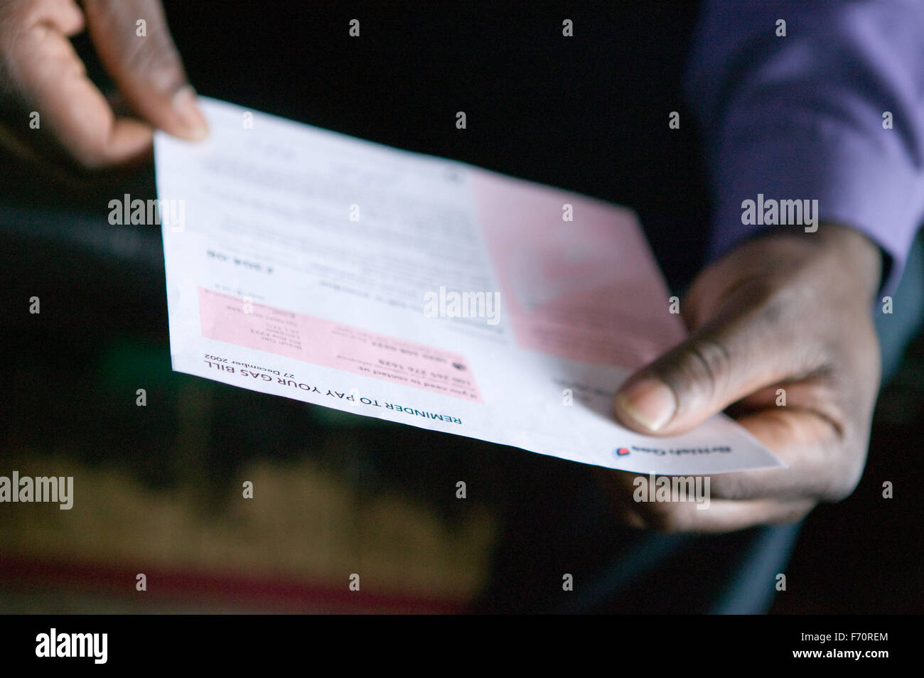 A household utility bill being read, - Stock Image