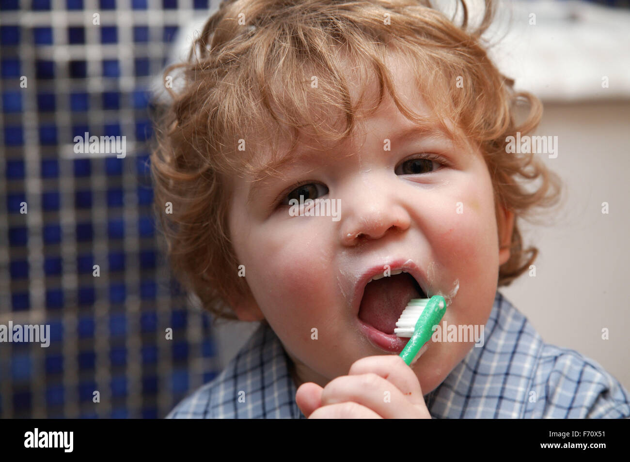 Baby boy learning to clean his own teeth, Stock Photo
