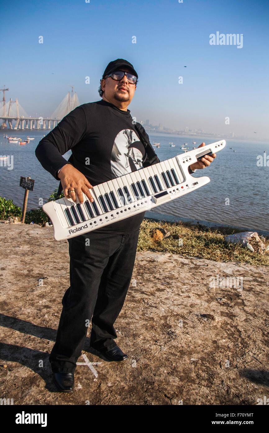 Louis banks playing synthesizer, worli, mumbai, maharashtra, india, asia - Stock Image