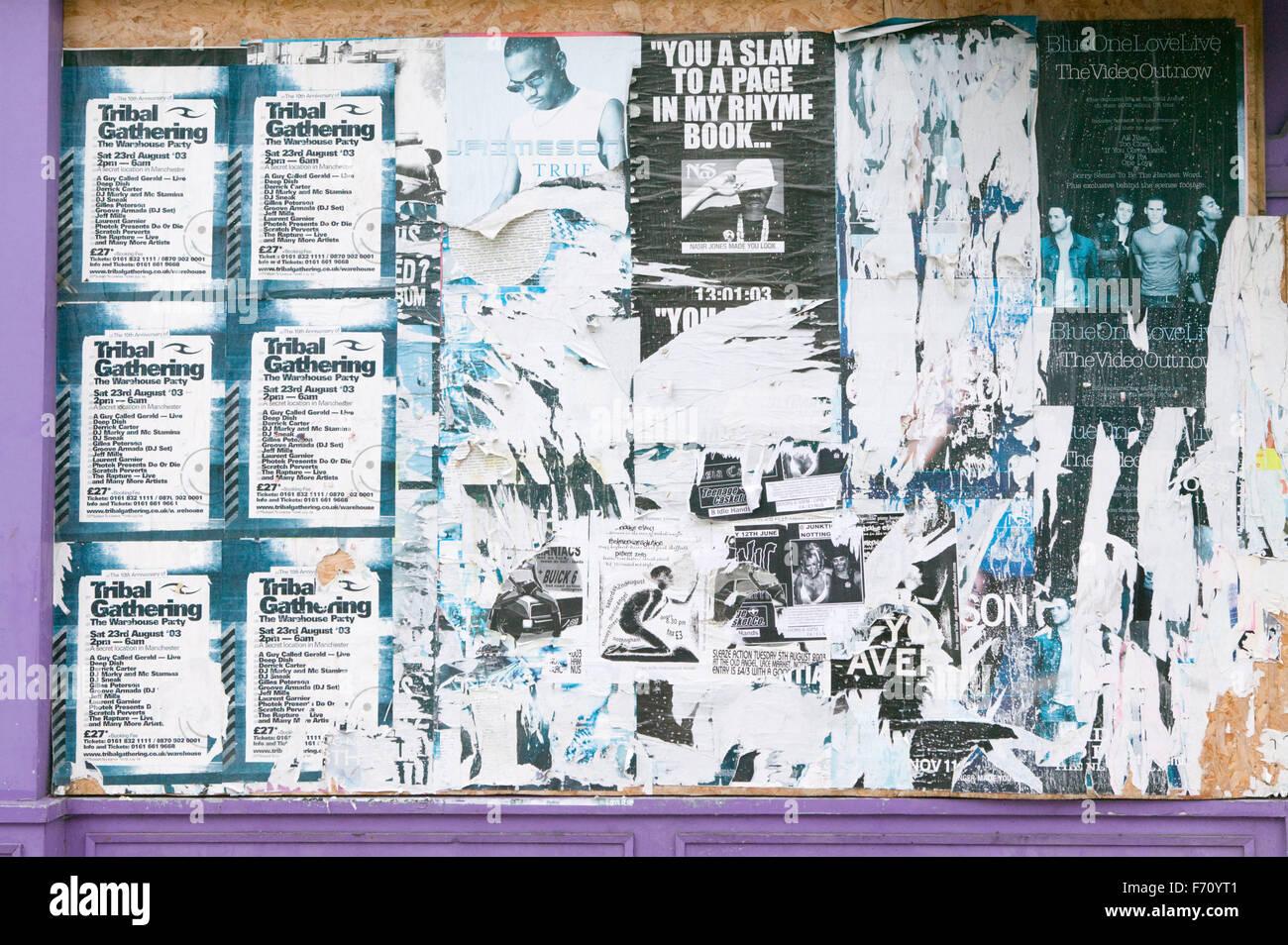 Old posters peeling off billboard, - Stock Image