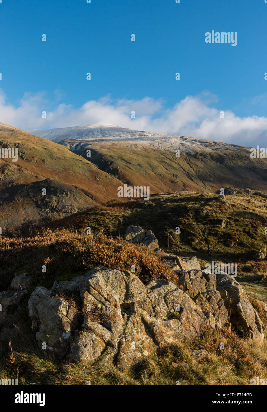snow capped watson's dodd in the distance which forms part of the helvellyn range - Stock Image
