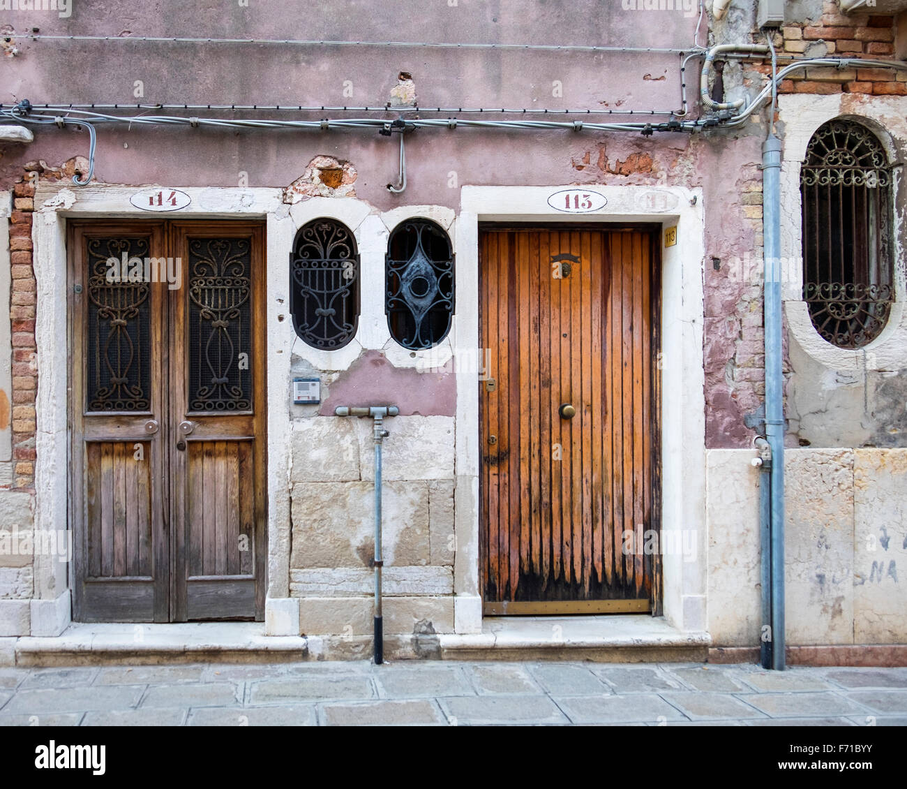Building exterior detail - weathered wooden doors and external electric wiring - Stock & Wooden Doors Stock Photos u0026 Wooden Doors Stock Images - Alamy