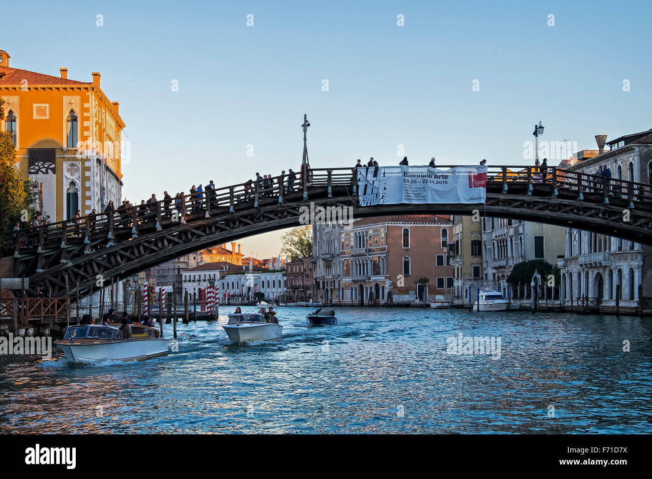 Italy, Venice, Grande Canale, Ponte Academia bridge, motor boats and grand riverside houses - Stock Image
