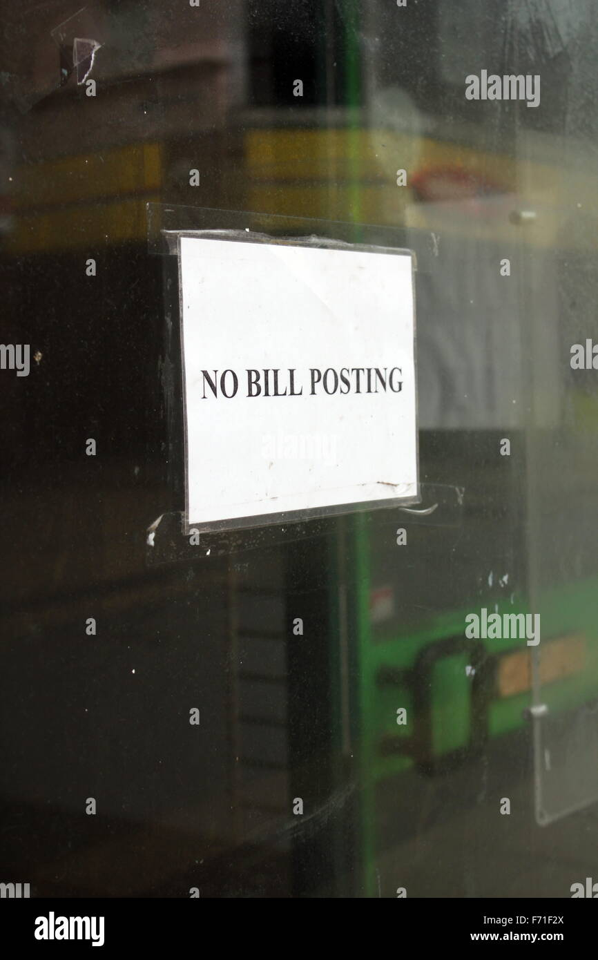 no bill posting sign notice on empty shop window in wales great britain uk - Stock Image