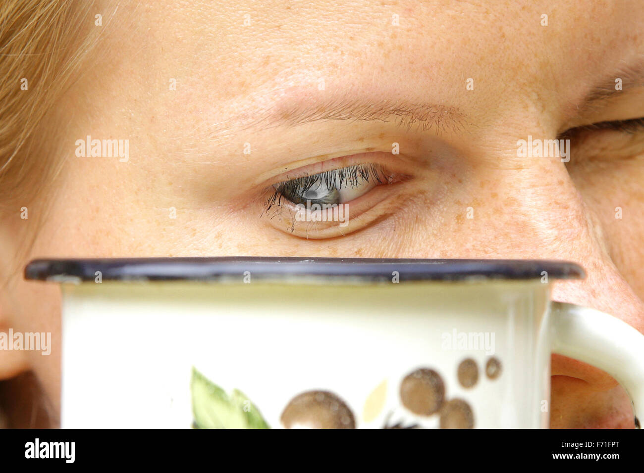 watched pot never boils proverb representing girl staring on kettle - Stock Image