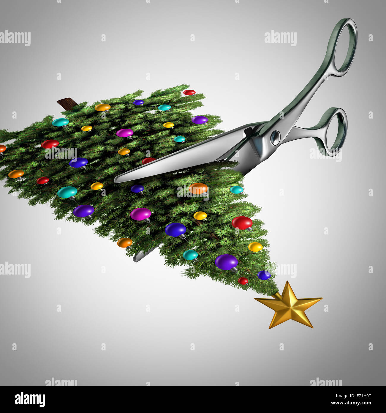 Cut back on christmas concept as scissors cutting a picture of a decorated christmas tree as a metaphor for trimming - Stock Image