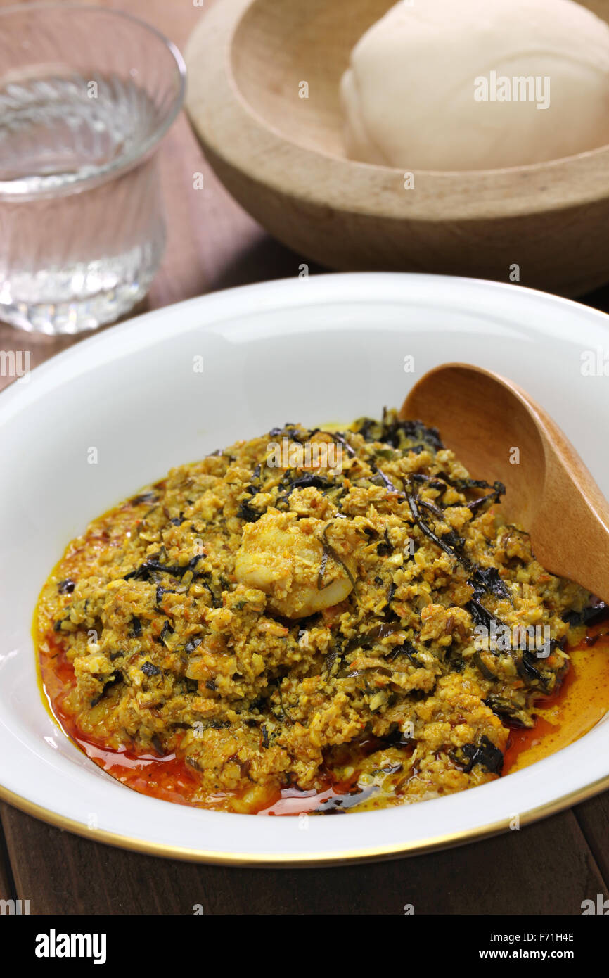 egusi soup and pounded yam, nigerian cuisine - Stock Image