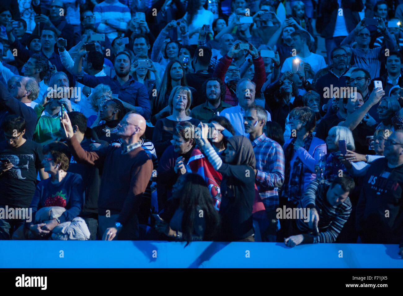 Fans await arrival of Novak Djokovic on court for the ATP World Tour Final 2015 match against Roger Federer at the - Stock Image