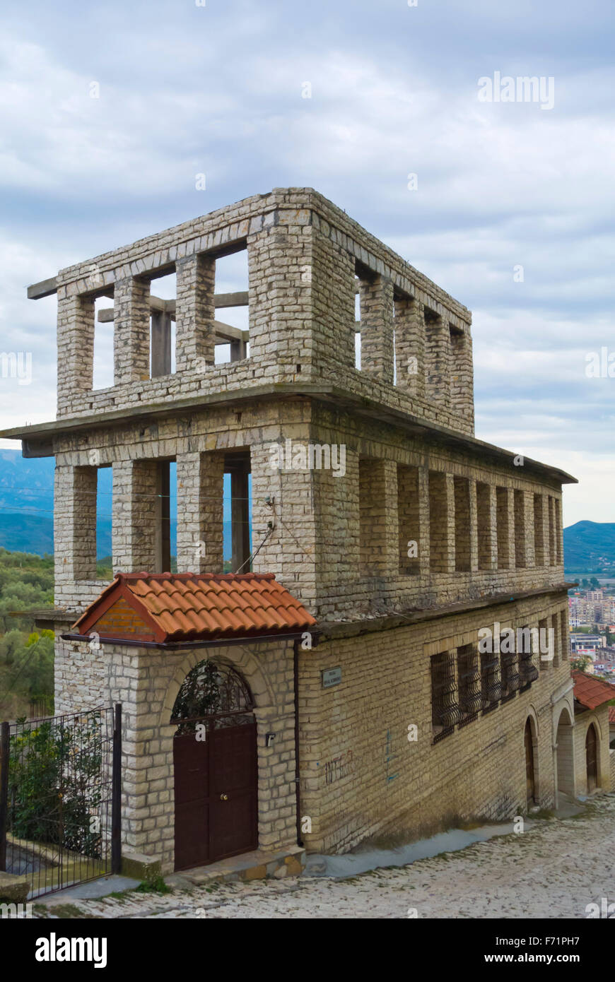 Unfinished residential building, Rruga Mihal Komnena, road to Kalaja, the castle, fortress hill, Berat, Albania - Stock Image