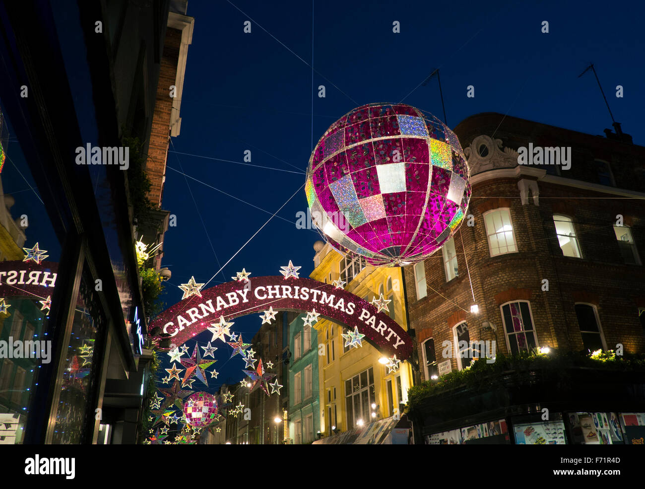 Christmas lights in Carnaby Street in the West End, London, UK - Stock Image