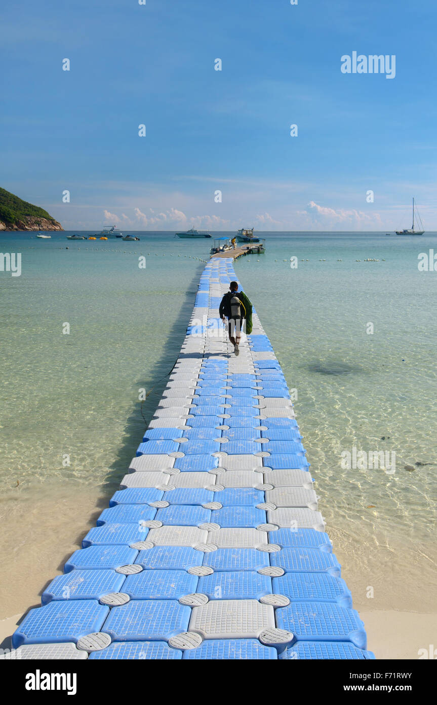 The diver is on a floating pier for diving boat, Redang Island, Malaysia, Asia - Stock Image