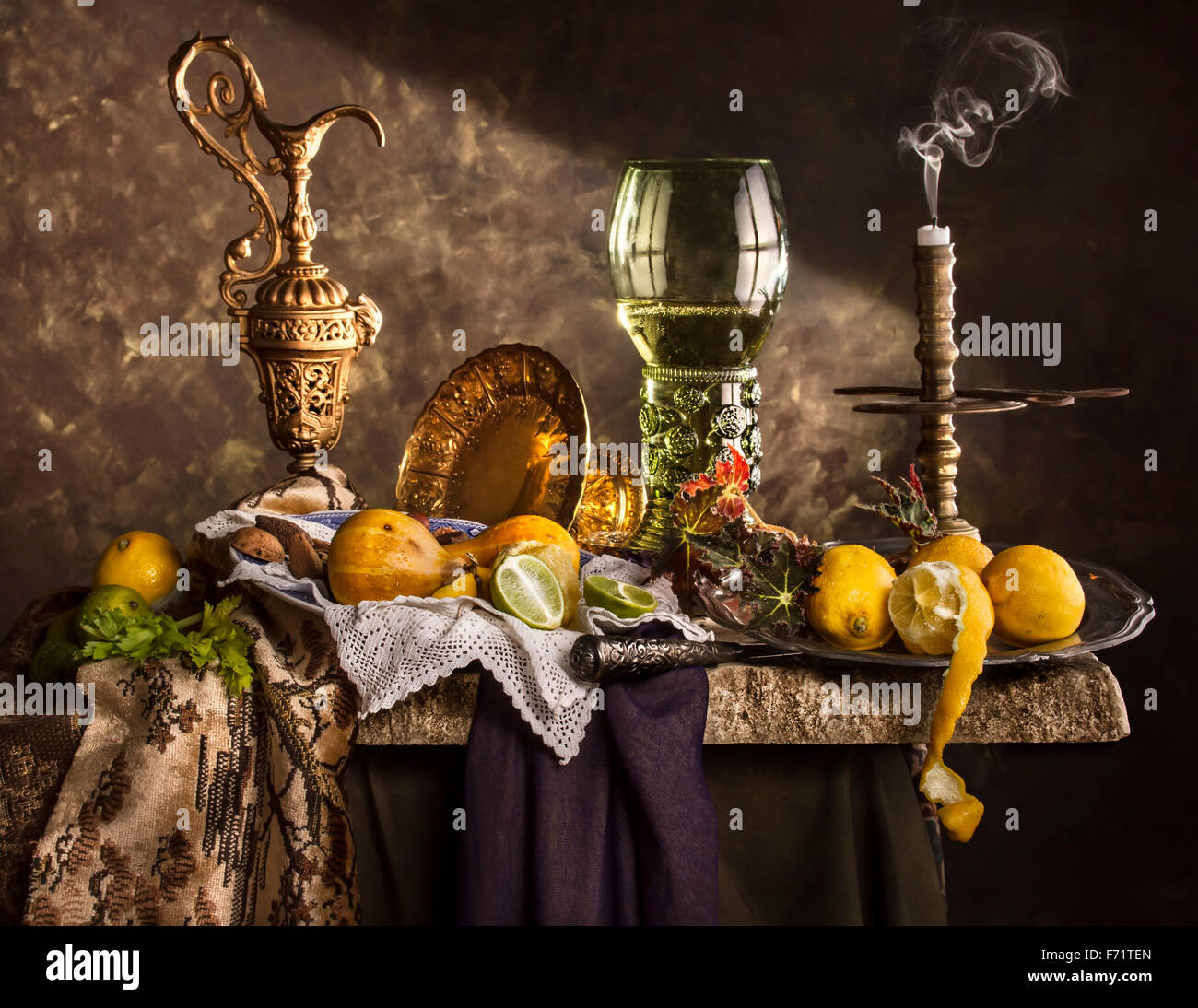 Still life composition with roemer glass and lemons - Stock Image