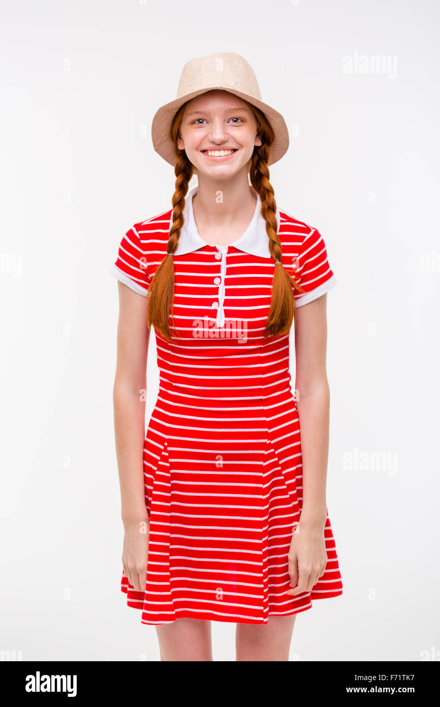 Portrait of amusing positive redhead girl with two braids in boonie hat and  casual dress posing on white background 6c4d447ce6a