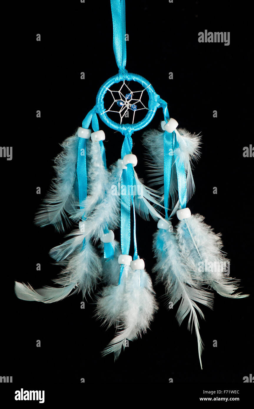 Turquoise dreamcatcher on the black background - Stock Image