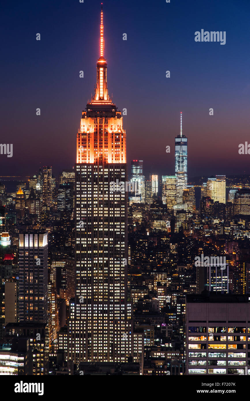 Top view of the Empire State Building with orange lights, Manhattan, New York, USA - Stock Image