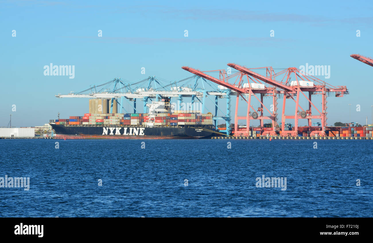Panama registered NYK Line container ship NYK Deneb being off loaded at the Norfolk Port of Virginia shipyards. - Stock Image