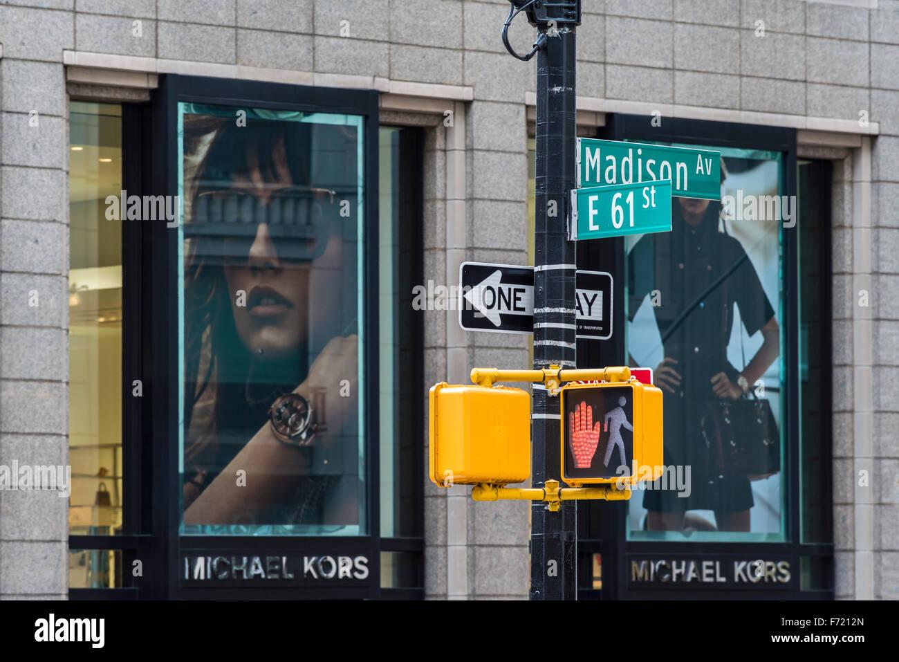Madison Avenue street sign and fashion shop behind, Manhattan, New York, USA - Stock Image