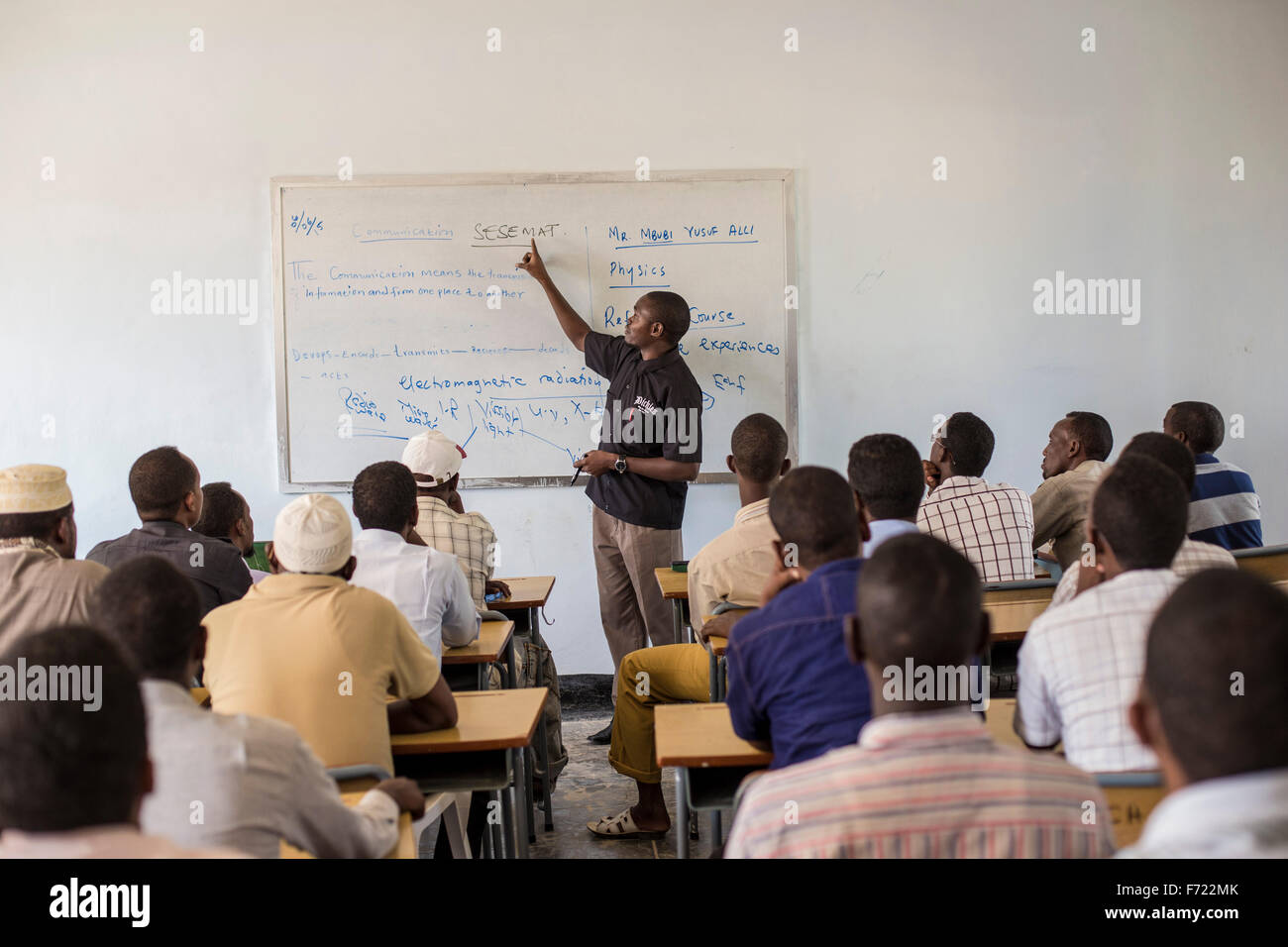 An instructor for the Somali Youth Learners Initiative teachers other teachers to improve and expand secondary education - Stock Image