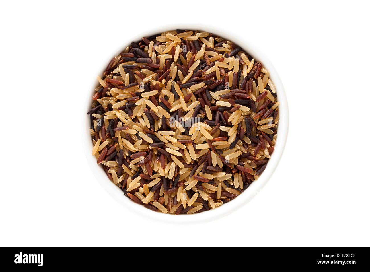 Wild rice mix in a cup isolated on a white background - Stock Image