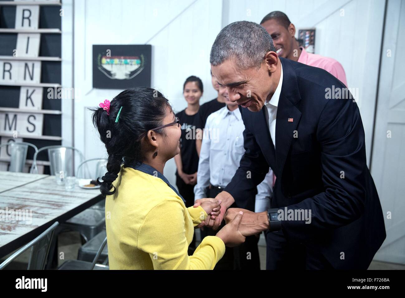 U.S. President Barack Obama speaks with a young girl during a tour of the Dignity for Children Foundation November - Stock Image