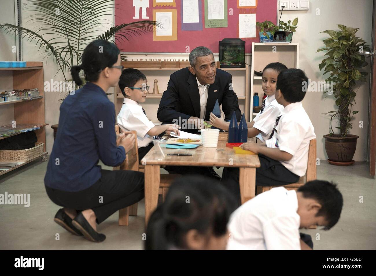 U.S. President Barack Obama speaks with a young boy during a tour of the Dignity for Children Foundation November - Stock Image