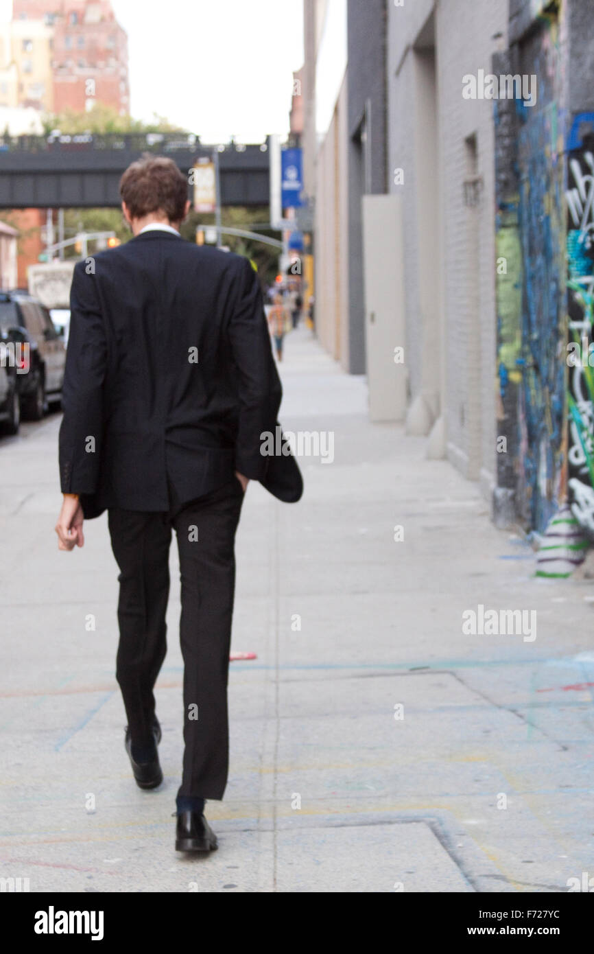 Street Style : A man walking in New York. Book Cover - Stock Image