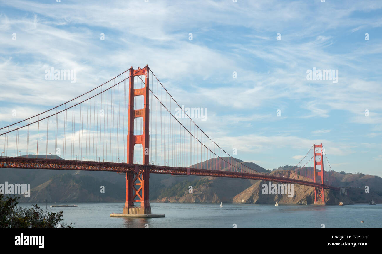 The Golden Gate Bridge with Wispy Clouds - Stock Image