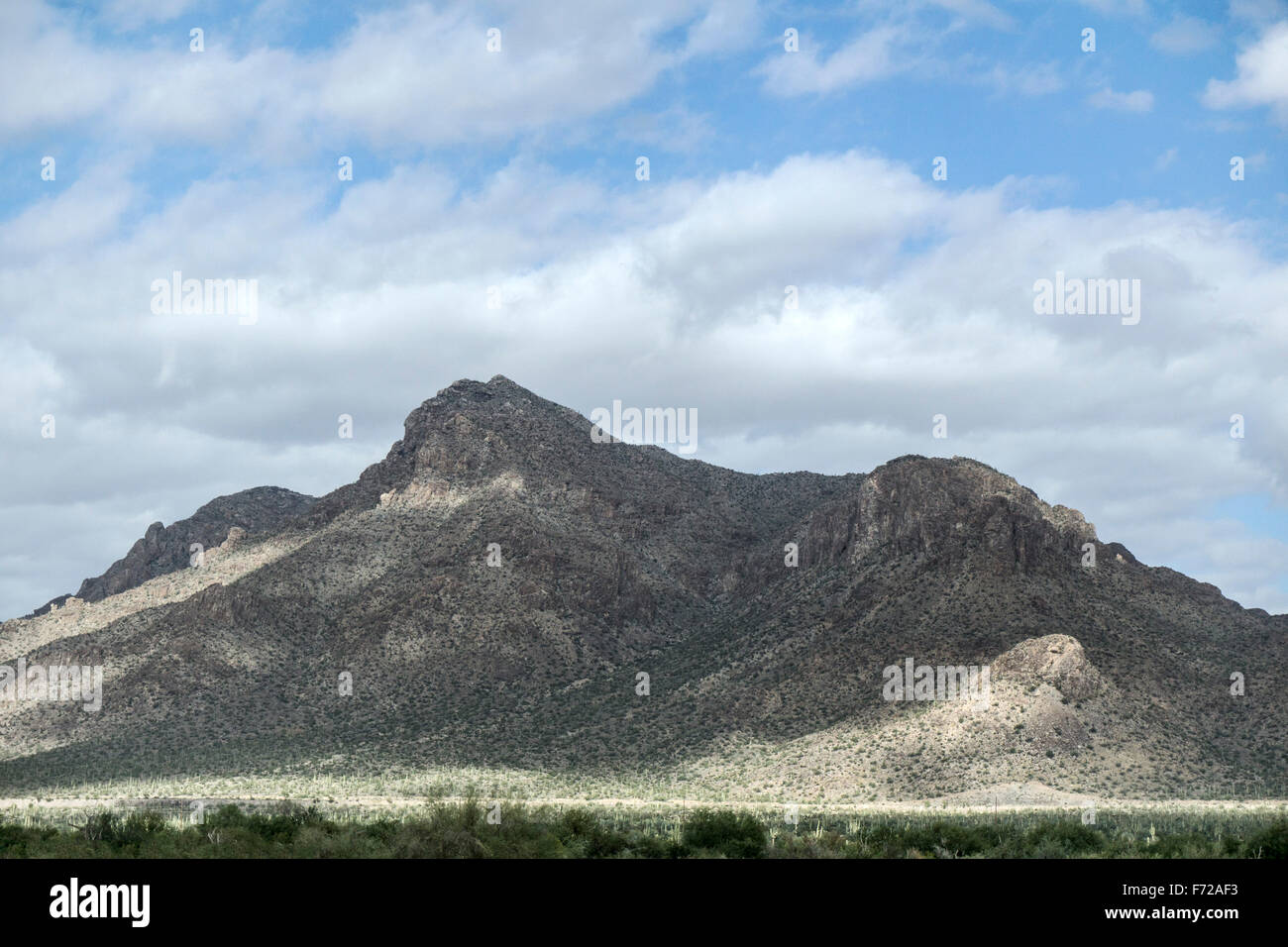 deep patches cloud shadow shadows clouds move swiftly across rugged iron rich mountains ringing Sonora desert Mexico - Stock Image