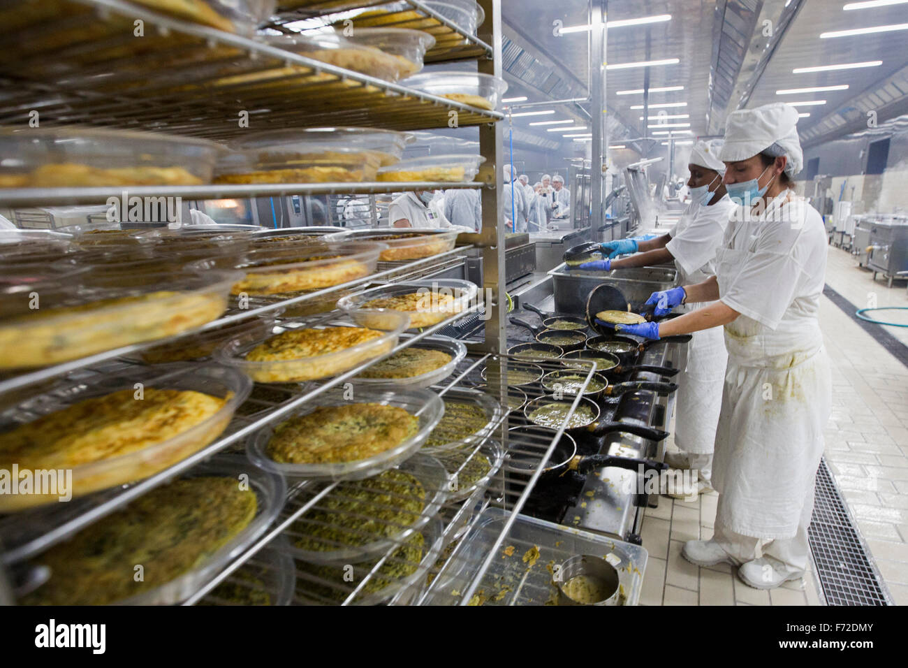 Workers on an industrial cooking services company in the spanish island of mallorca - Stock Image