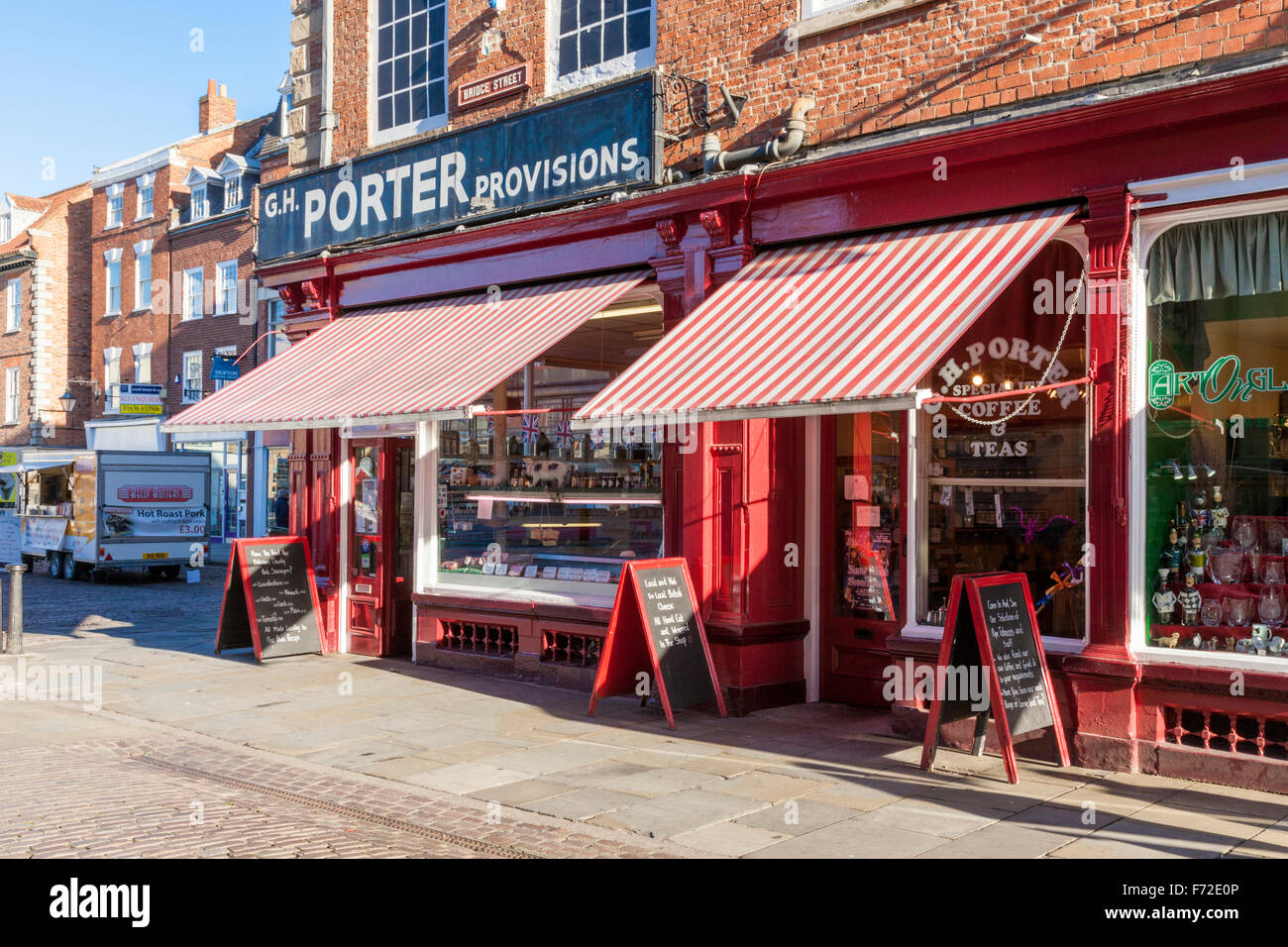 Traditional butcher shop and café with awnings. Newark on Trent, Nottinghamshire, England, UK - Stock Image
