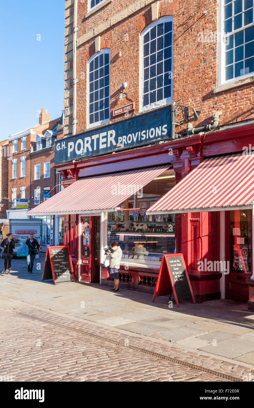 Traditional butcher shop with awnings. Porter Provisions in Newark on Trent, Nottinghamshire, England, UK - Stock Image