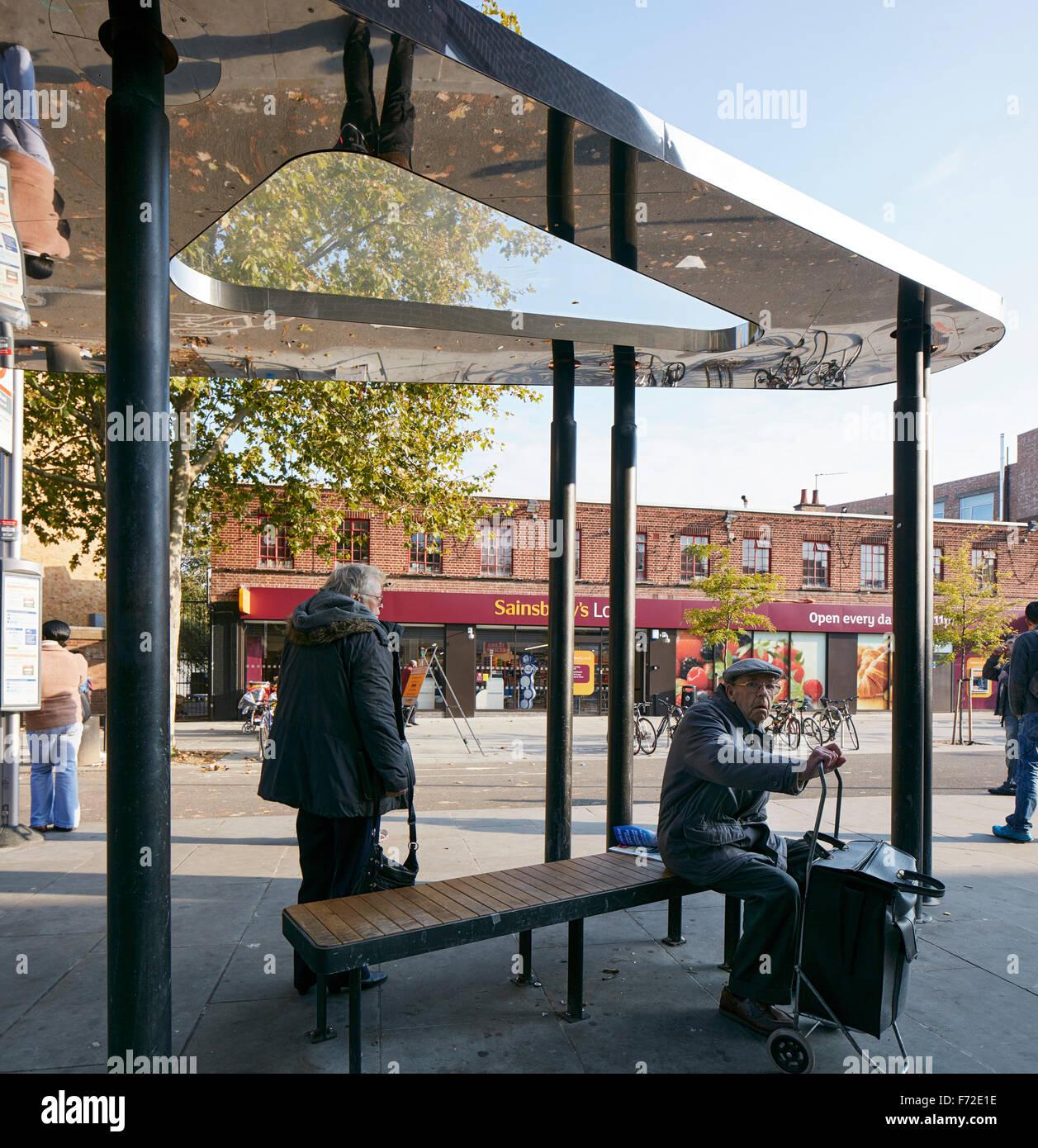 Bus shelter with senior citizen waiting. Binfield Road Bus Shelter, Stockwell Framework Masterplan, London, United - Stock Image