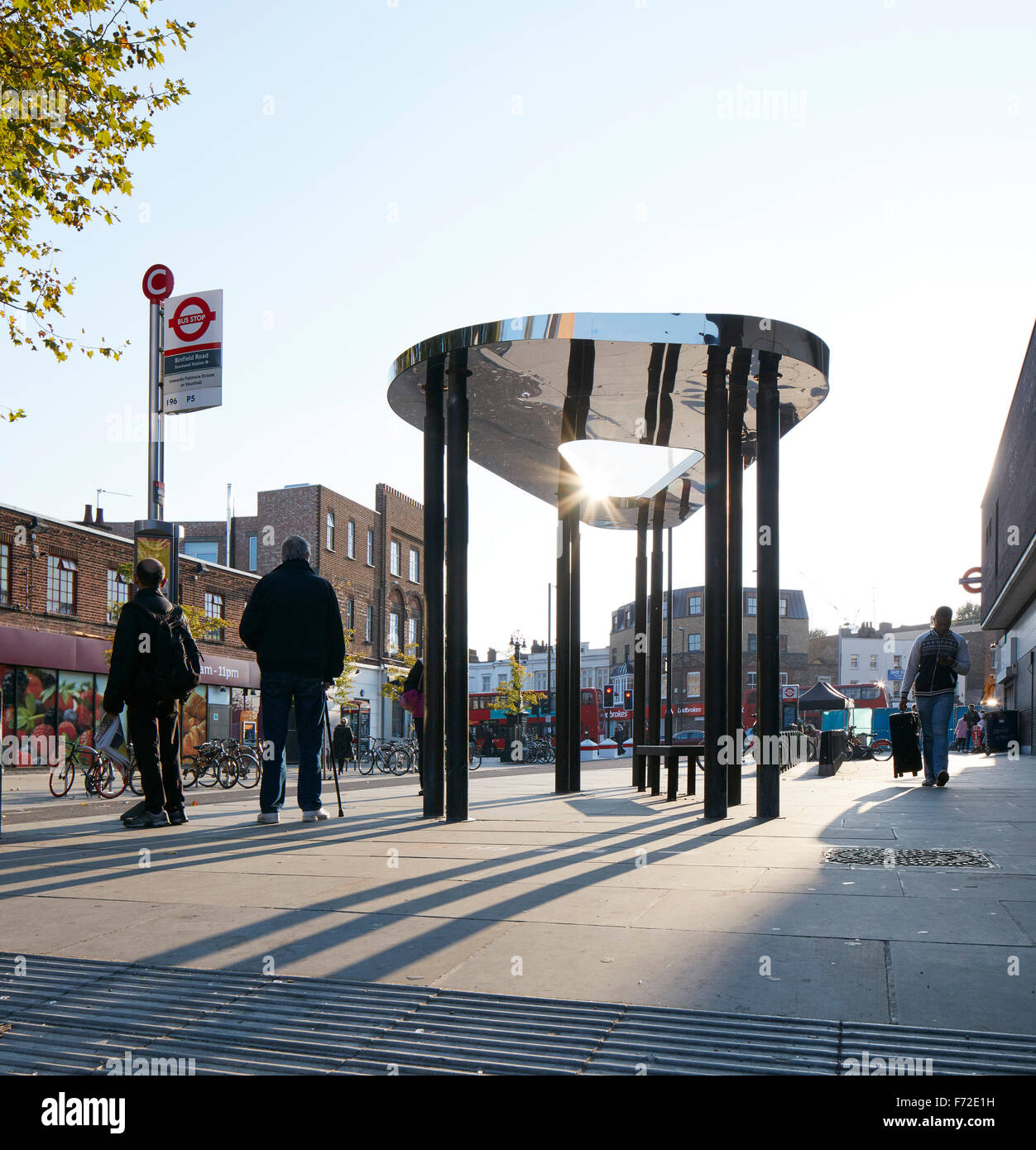 Backlit bus shelter in context. Binfield Road Bus Shelter, Stockwell Framework Masterplan, London, United Kingdom. - Stock Image