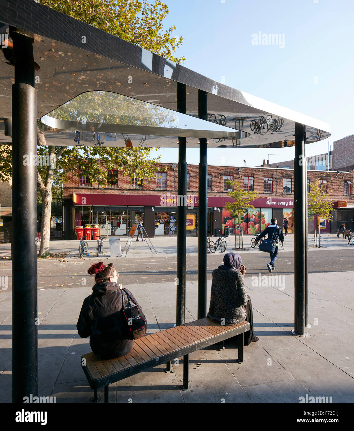 Bus shelter with bench and morning light. Binfield Road Bus Shelter, Stockwell Framework Masterplan, London, United - Stock Image