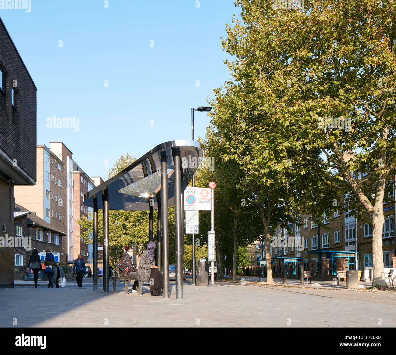 Pedestrianised area of Binfield Rd with bus shelter. Binfield Road Bus Shelter, Stockwell Framework Masterplan, - Stock Image