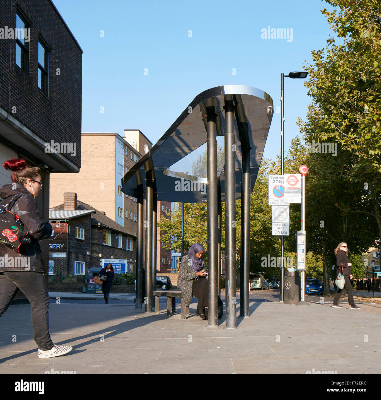 Pedestrianised area of Binfield Rod with bus shelter. Binfield Road Bus Shelter, Stockwell Framework Masterplan, - Stock Image
