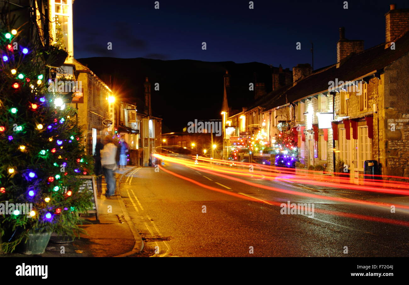 Christmas decorations light up the main street in Castleton, a village in the Hope Valley, Peak District Derbyshire Stock Photo