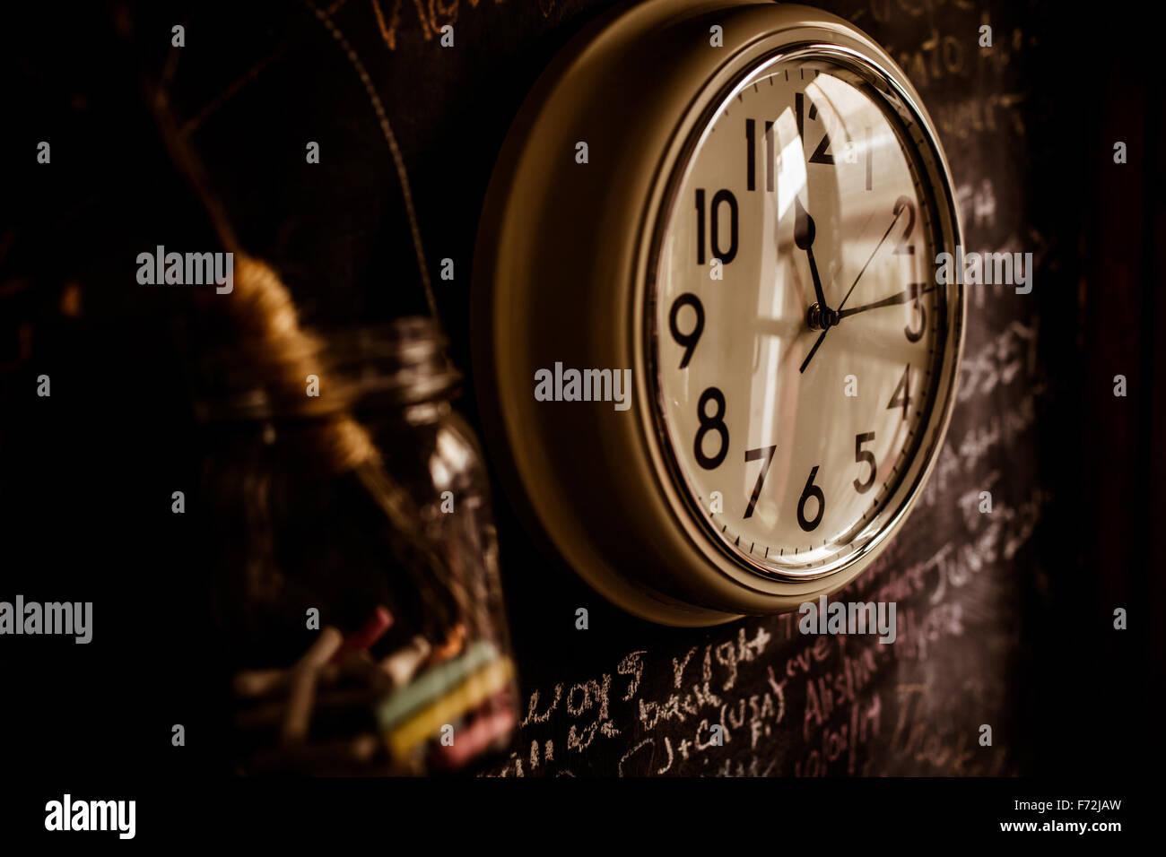 Clock on kitchen wall - Stock Image