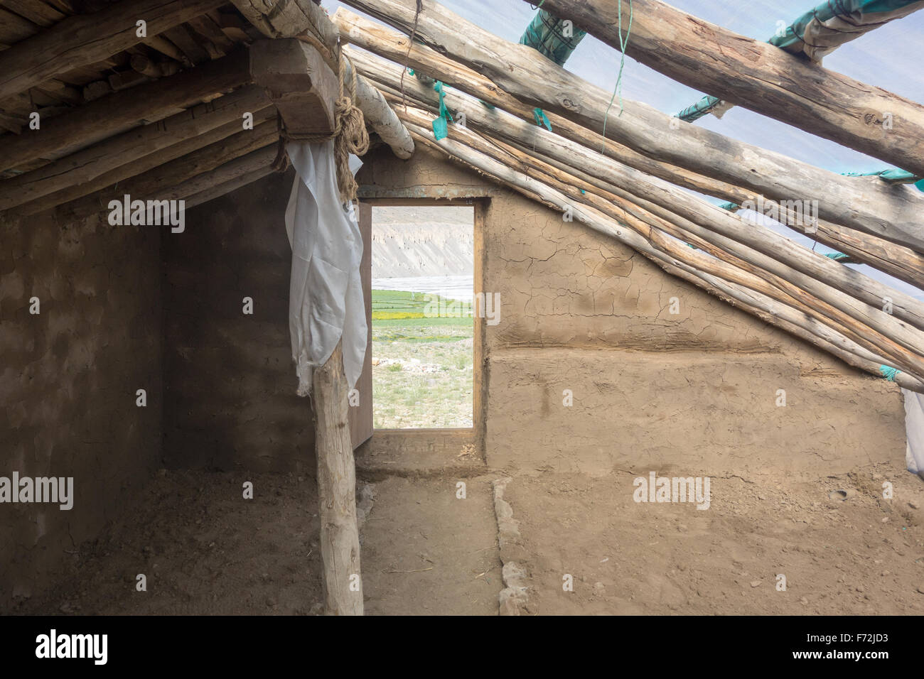 Spiti Valley volunteer greenhouse building project - Ecosphere - inside a newly completed greenhouse - Stock Image