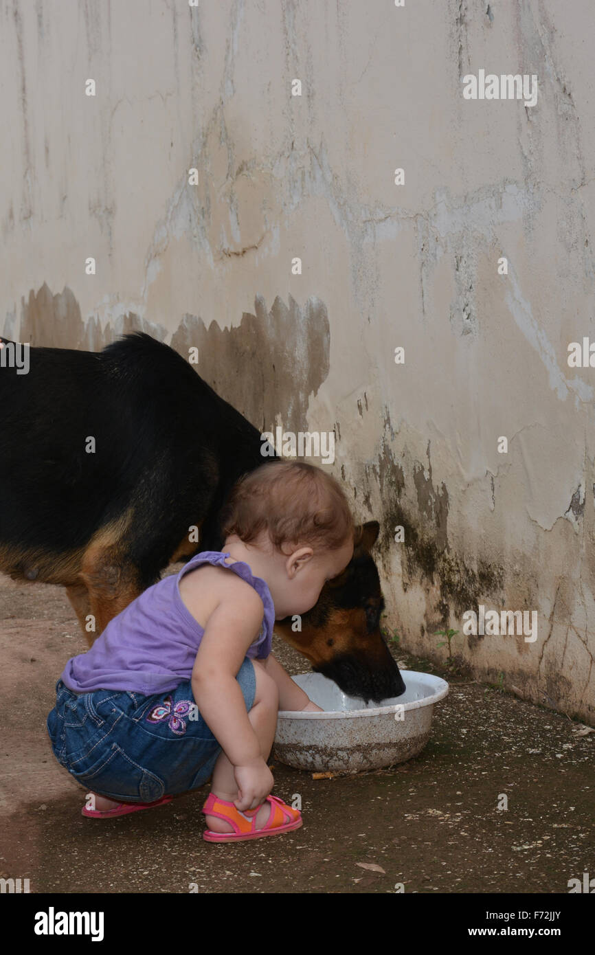 What are you eating - let me taste! - Stock Image