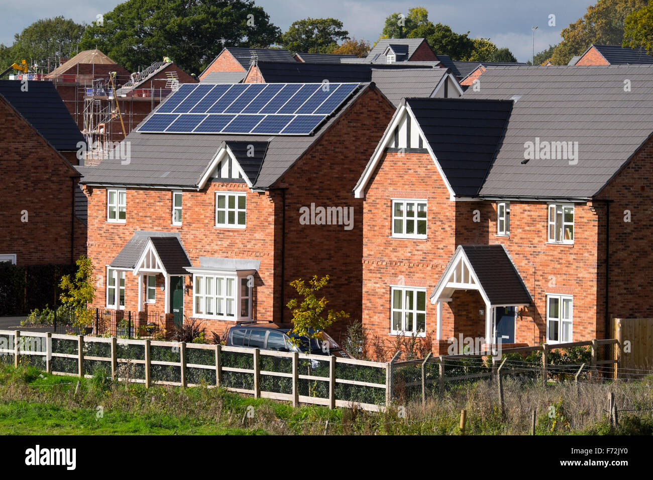 A detached house in Ellesmere, Shropshire, fitted with photovoltaic panels. - Stock Image