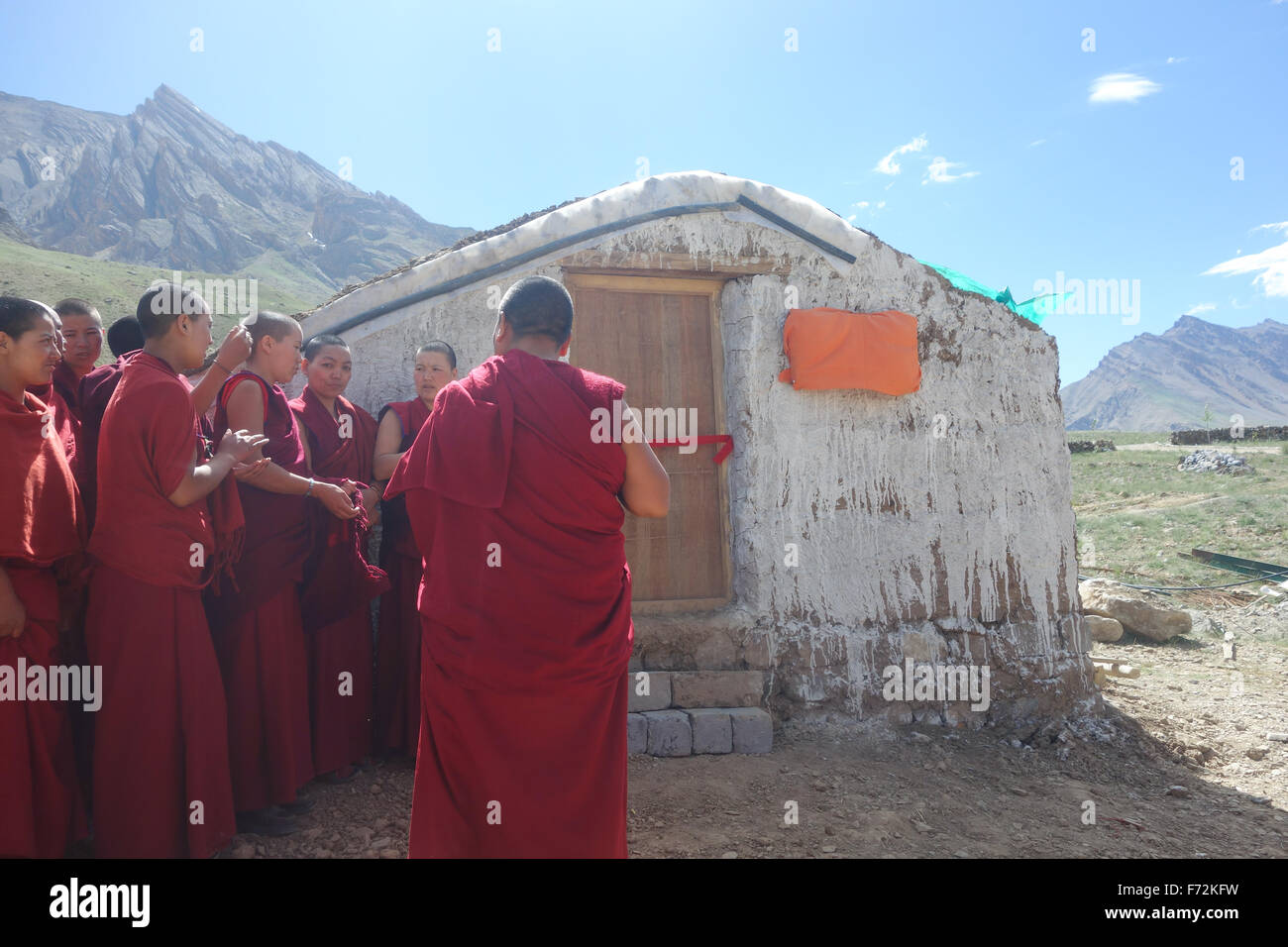 Buddhist nuns at the opening of a new social enterprise/volunteer built greenhouse - Spiti Valley, Indian Himalayas - Stock Image