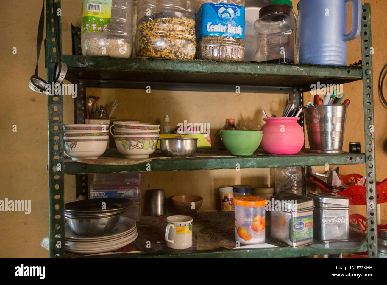 Kitchen shelves in remote Himalayan homestay accommodation - Spiti Valley, Himachal Pradesh, India - Stock Image