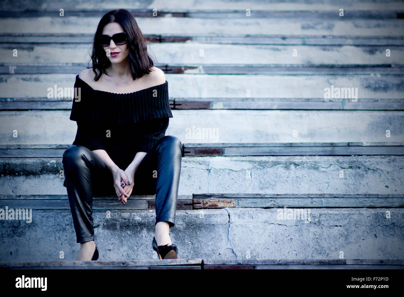 827ef59ccf6 Attractive woman in black leather pants, black sweater and high ...