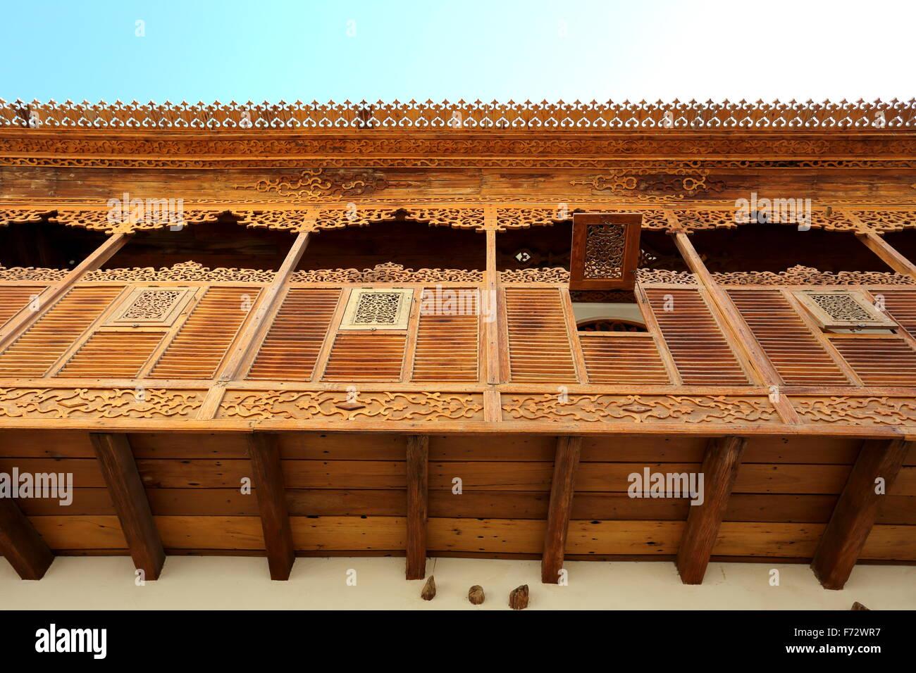 Covered wooden balcony, Khalaf House, Manama, Kingdom of Bahrain - Stock Image
