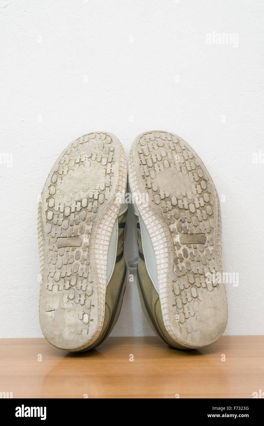 worn out shoes - Stock Image